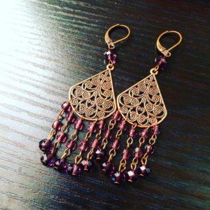 Amethyst crystal chandelier earrings in antique copper brass. $25