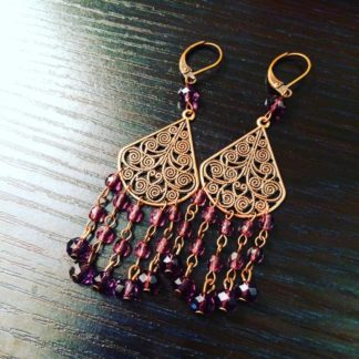 Amethyst crystal chandelier earrings in antique copper brass. $25